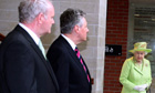 Peter Robinson and deputy first minister Martin McGuinness wait to meet Queen Elizabeth in Belfast