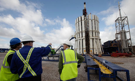 Engineers look at the Cuadrilla shale fracking facility in Preston, Lancashire
