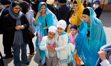 Families at a Sikh temple during the Labour campaign