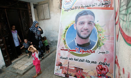 Mahmoud Sarsak's relatives gather around poster