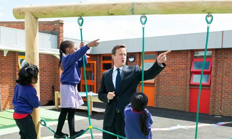David Cameron enjoys playtime with pupils during a visit to a school in Edmonton, north London.