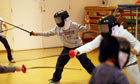 Children participate in fencing lessons