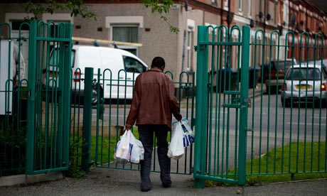 A man leaves the Mosaic Church food bank in Coventry, July 2012