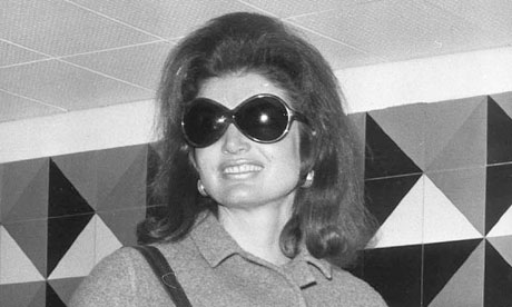 A good look … for her. Jackie O in her trademark glasses.