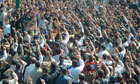 Anti-government protesters shout anti-Assad slogans during the funeral of Sunnis killed near Homs