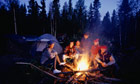 Group sitting round a camp fire