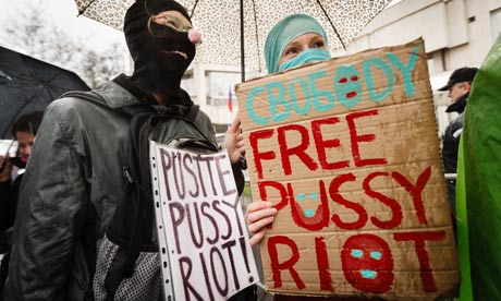 "Protesters holding multilingual ""Free Pussy Riot"" signs"
