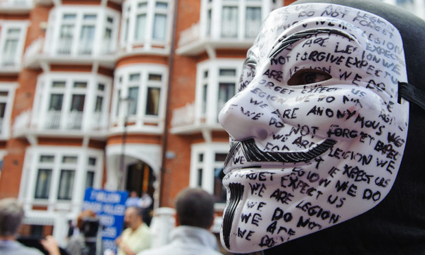 A masked supporter of Julian Assange outside Ecuador's embassy in Knightsbridge, London.