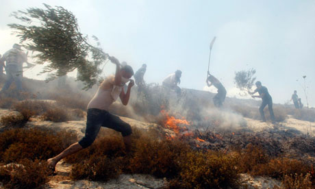 Palestinian villagers and firefighters