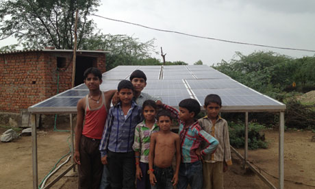 Children in Khareda Lakshmipura, Rajasthan, with the Gram Power installation