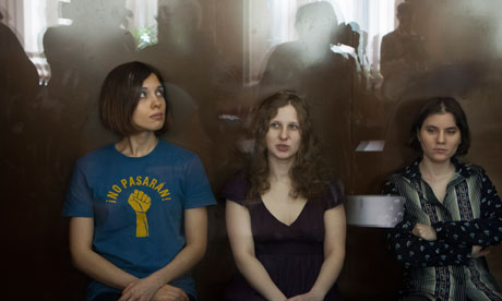Pussy Riot members, from left, Nadezhda Tolokonnikova, Maria Alyokhina and Yekaterina Samutsevich sit in a glass cage at a court room in Moscow. Photograph: Alexander Zemlianichenko/AP