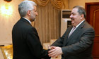 Iraq's foreign minister Hoshyar Zebari (r) welcomes Iran's national security chief Saeed Jalili.