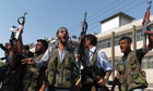 Free Syrian Army members holding  guns
