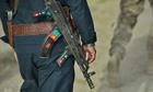 Afghan police walks behind US soldier