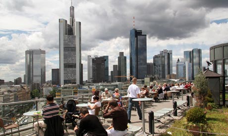 People relax in front of Frankfurt's banking distr