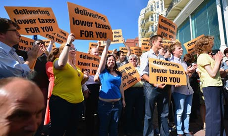 Lib Dem activists in Brighton wave placards as Nick Clegg arrives for the party conference.