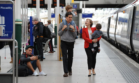 Ed Miliband and family arrive at Manchester Piccadilly station ahead of Labour's party conference.