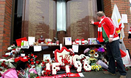 Liverpool supporter pays his respects at the Hillsborough memorial