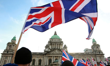 Loyalist protesters hold union flags outside Belfast City Hall