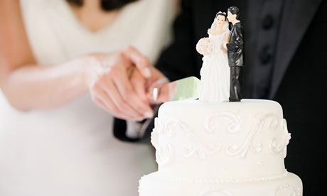 Newlyweds cutting wedding cake