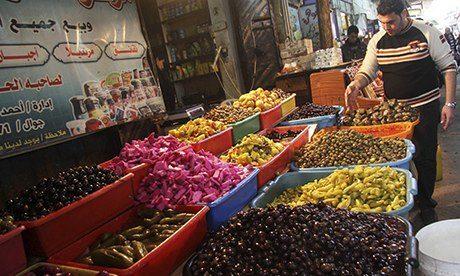 A vendor sells pickles at al-Zawiya market in Gaza City