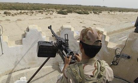 An Iranian border guard keeps watch