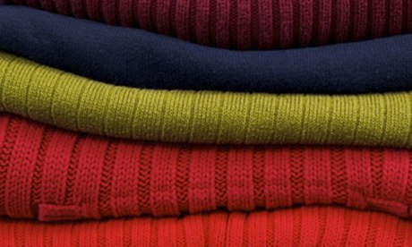 Neat pile of woollen jumpers