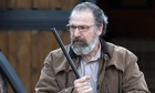 Mandy Patinkin as Saul Berenson, with rifle, in Homeland