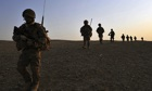 Silhouette of British soldiers patrolling in Helmand
