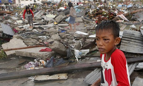 Image of a child staring ahead helplessly after Haiyan's rampage