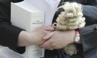 A female barrister holds her wig