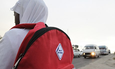 Tanzanian child wearing high-viz backpack
