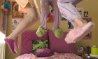 teenage girls jumping on a bed