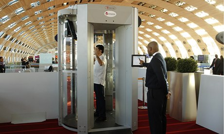 A man inside a full-body scanner being trialled at Charles-de-Gaulle airport