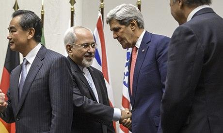 Javad Zarif shakes hands with John Kerry