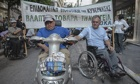 Disabled and older people stage a rally outside the ministry of employment in central Athens