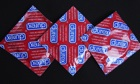 Three Durex condoms, contraceptives