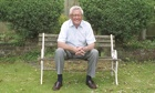 John Cole sitting smiling on a garden bench