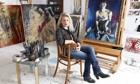 Portrait painter Alice Instone artist in her studio at home in Kent.