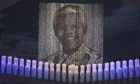 Candles lit under a portrait of Mandela for the funeral ceremony in Qunu.