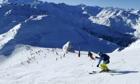 People ski on the top of Saulire mountain in Meribel