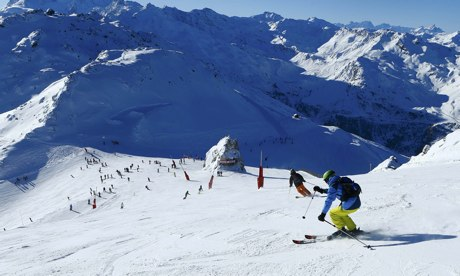 People ski on the top of Saulire mountain in Meribel