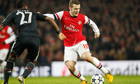 Jack Wilshere takes on Bayern Munich's David Alaba