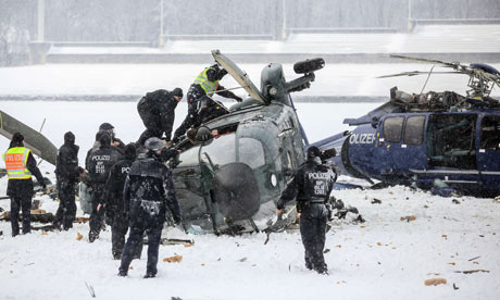 Officers at the scene where two police helicopters crashed near the Olympic stadium, in Berlin.