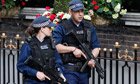 Armed police officers patrol outside The Goring hotel in London