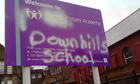 Harris Academy sign with 'Downhills school' graffitied over it