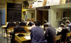 Prisoners at desks in a classroom in Saughton Prison
