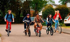 Film still from All Stars – youths on bicycles