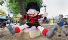 Dennis the Menace in a sand pit outside the Southbank Centre