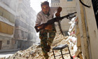 A Free Syrian Army fighter running for cover in Aleppo